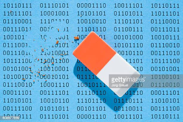binary data being deleted by an eraser - eraser stock pictures, royalty-free photos & images