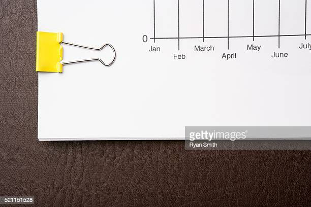 Binder Clip Holding a Bundle of Papers