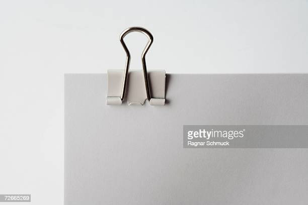 binder clip on document - binder clip stock pictures, royalty-free photos & images