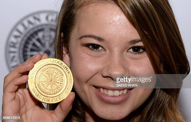 Bindi Irwin, daughter of late Steve 'Crocodile Hunter' Irwin, displays the medal for young conservationist of the year during a media call for the...