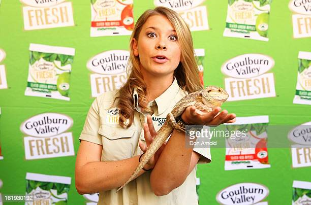 Bindi Irwin poses with a pet lizard during the Goulburn Valley Fresh launch at Martin Place on February 18 2013 in Sydney Australia