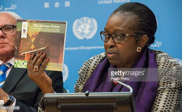 Bineta Diop displays a copy of a book detailing the roles of women within the African Union regarding security and peacemaking operations The Office...