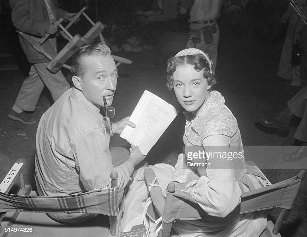 Bing Crosby and British actress Julie Andrews look over a script of a musical version of Maxwell Anderson's play High Tor This is one of a series...