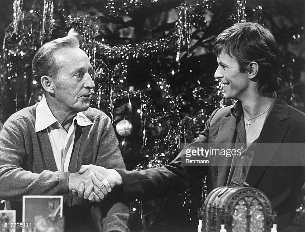 Bing Crosby and David Bowie shake hands during the taping of the television special Bing Crosby's Merrie Olde Christmas The two singers of diverse...