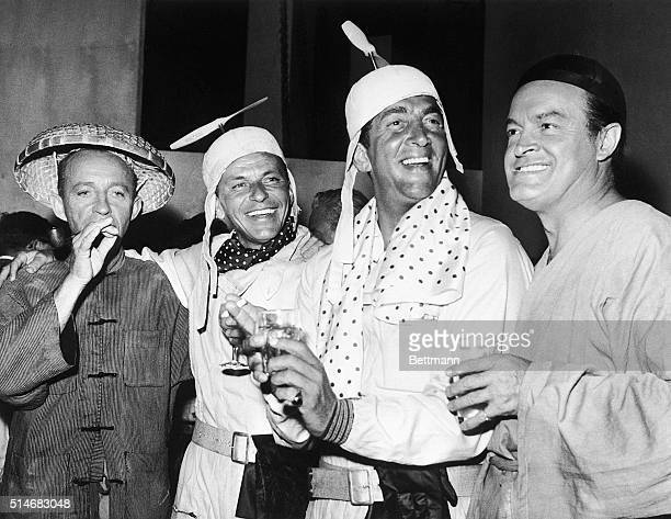Bing Crosby, Frank Sinatra, Dean Martin, and Bob Hope fool around on the set of the 1961 film The Road to Hong Kong.