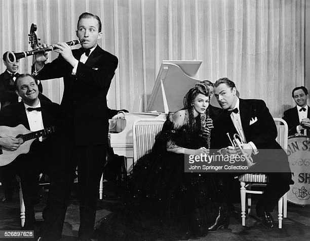 Bing Crosby plays the oboe as Jeff Lambert in the 1941 film Birth of the Blues. Marty Martin as Betty Lou Cobb, and Brian Donlevy as Memphis.