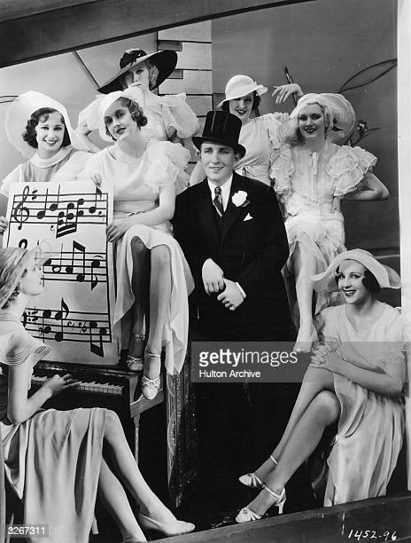 Bing Crosby the popular American crooner at the centre of a group of dancers in the light musical 'Too Much Harmony' directed by A Edward Sutherland...