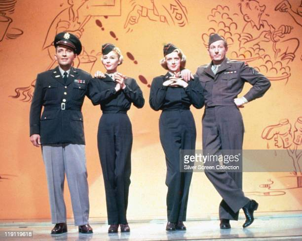 Bing Crosby VeraEllen Rosemary Clooney Danny Kaye all dressed in military uniform in a publicity still issued for the film 'White Christmas' USA 1954...
