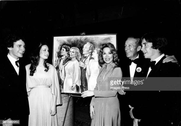 Bing Crosby wife Kathryn Crosby and family photographed with a piece of artwork circa 1977 in New York City