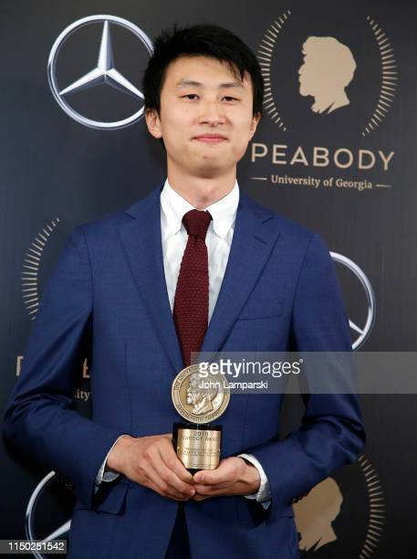 Bing Liu and guests pose in the Press Room at the 78th Annual Peabody Awards at Cipriani Wall Street on May 18 2019 in New York City
