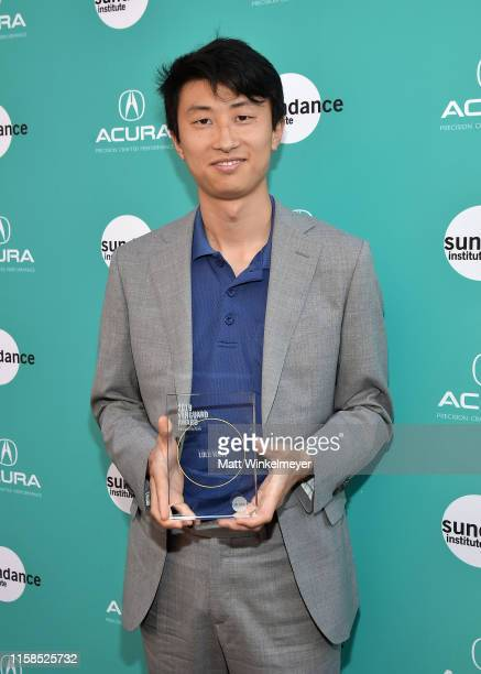 Bing Liu holds the Vanguard Award during The Farewell LA premiere presented by Sundance Institute and hosted by Acura at The Theatre at Ace Hotel on...
