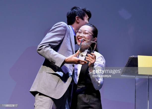 Bing Liu presents Lulu Wang the Vanguard Award onstage during The Farewell LA premiere presented by Sundance Institute and hosted by Acura at The...