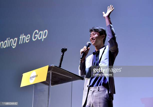Bing Liu presents the Vanguard Award to Lulu Wang onstage during The Farewell LA premiere presented by Sundance Institute and hosted by Acura at The...