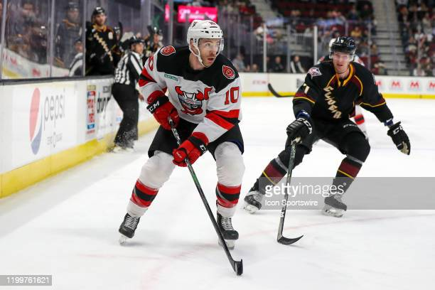 Binghamton Devils center Ben Street controls the puck during the first period of the American Hockey League game between the Binghamton Devils and...