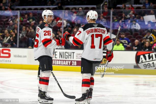 Binghamton Devils center Egor Sharangovich is congratulated by Binghamton Devils center Ryan Schmelzer after scoring a goal during the third period...