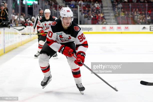 Binghamton Devils forward Jesper Boqvist passes the puck during the third period of the American Hockey League game between the Binghamton Senators...