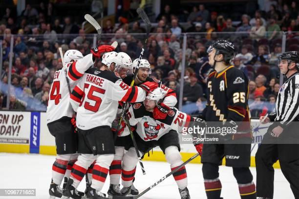 Binghamton Devils left wing Eric Tangradi is mobbed by teammates Binghamton Devils defenceman John Ramage , Binghamton Devils Egor Yakovlelv,...