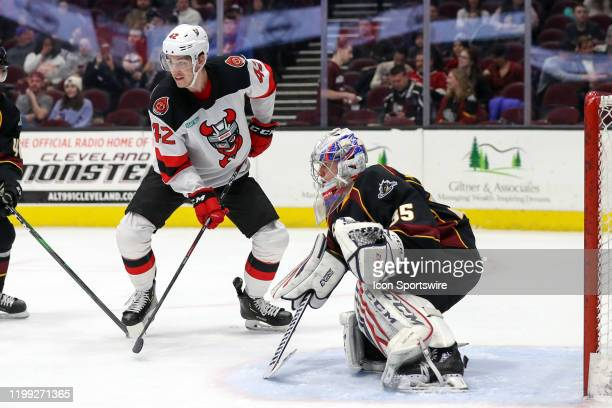Binghamton Devils right wing Nathan Bastian looks for a pass in front of Cleveland Monsters goalie Veini Vehvilainen during the first period of the...