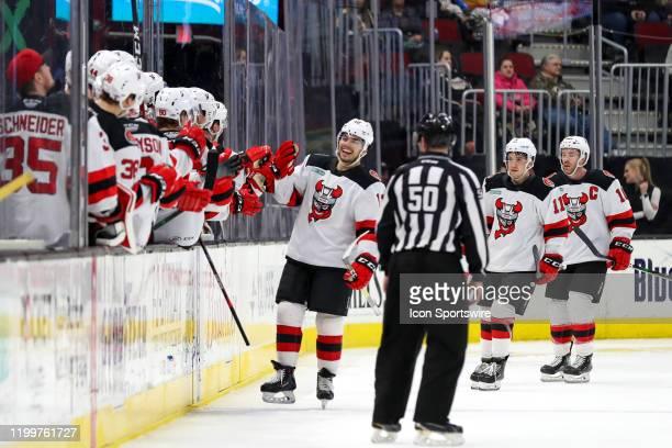 Binghamton Devils right wing Nick Merkley is congratulated by teammates after scoring a goal during the second period of the American Hockey League...