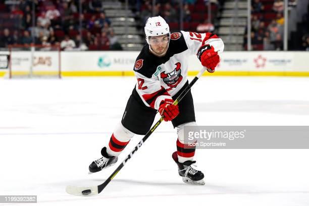 Binghamton Devils right wing Nick Merkley shoots the puck during the third period of the American Hockey League game between the Binghamton Senators...