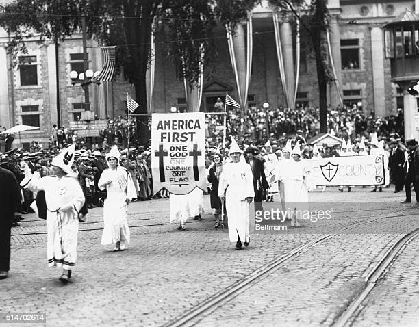 Ku Klux Klan stages an 'America First' parade in Binghamton NY Photograph 1920's