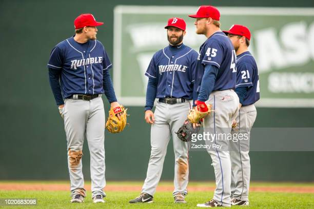 Binghamton Rumble Ponies infielders gather during a pitching change in a game between the Portland Sea Dogs and the Binghamton Rumble Ponies at...