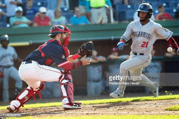 July 12: Binghamton Rumble Ponies Luis Carpio heads to home plate as Sea Dogs catcher Austin Rei waits for the throw in the suspended game from...