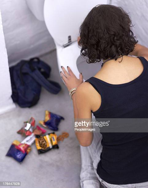 binging and purging - eating disorder stock pictures, royalty-free photos & images