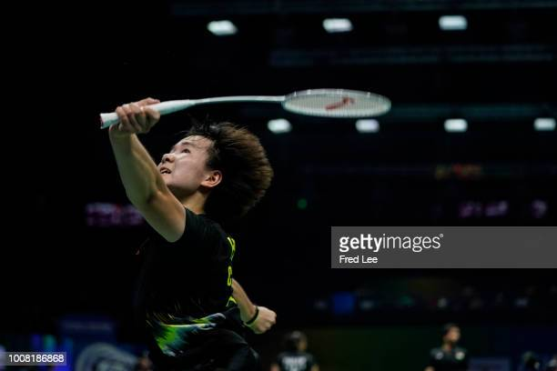 Bingjiao of China competes in the Women's Singles second round match against against Yip Pui Yin of Hong Kong on day two of TOTAL BWF World...
