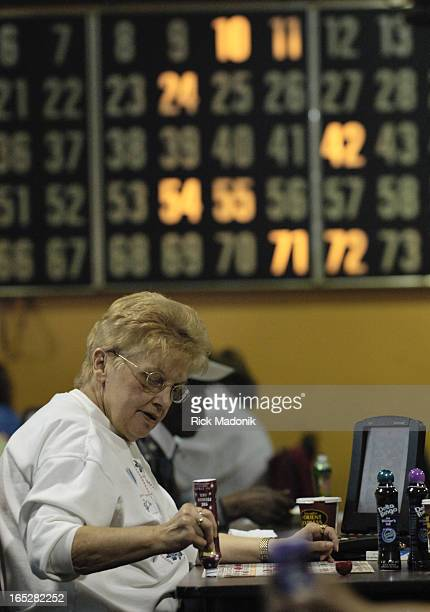 bingo 04/09/06 TORONTO ONTARIO A woman tracks the caller during an afternoon bingo game at the same bingo hall a man was died after being assualted...