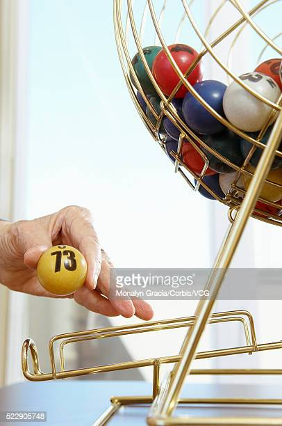 Bingo ball in woman's hand
