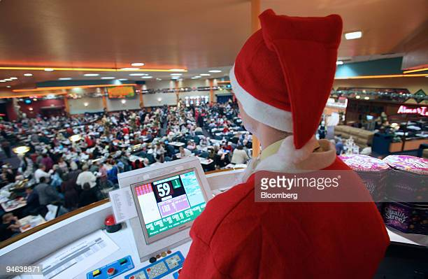 A bingo caller calls numbers at Beacon Bingo in Cricklewood Broadway north London on Wednesday December 13 2006 Bingo parlors once the realm of...