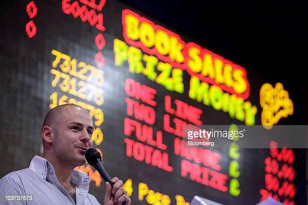 Bingo caller Kevin Saunders calls the numbers at a Gala Bingo club operated by Gala Coral Group Ltd in London UK on Thursday Aug 26 2010 Gala Coral...