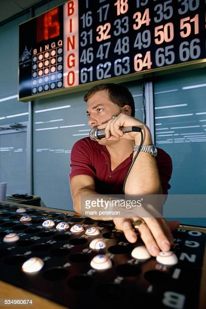 A bingo caller of Otoe's Bingo Parlor in Red Rock announces the winning numbers of bingo to the players