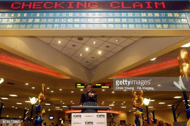 A Bingo caller waits as a claim is verified at the Mecca Bingo in Wandsworth South London concentrate on their score cards Bingo has about 3 million...