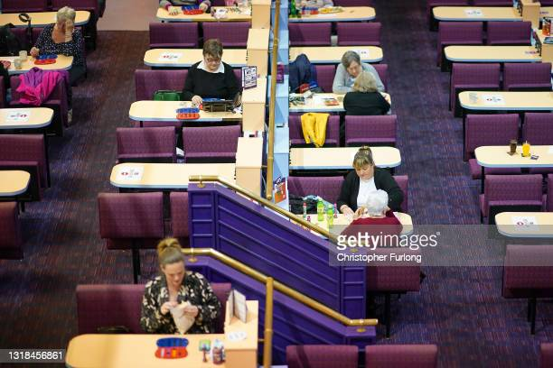 Bingo fans play at The Apollo Bingo Hall for their first game after the easing of lockdown restrictions in Wales on May 17, 2021 in Rhyl, United...