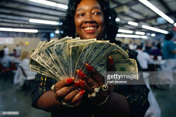 A bingo player holds her winnings The gambler is a member of Jeanne's Bingo Buddies a bingo club that travels from Houston to Oklahoma to play at...