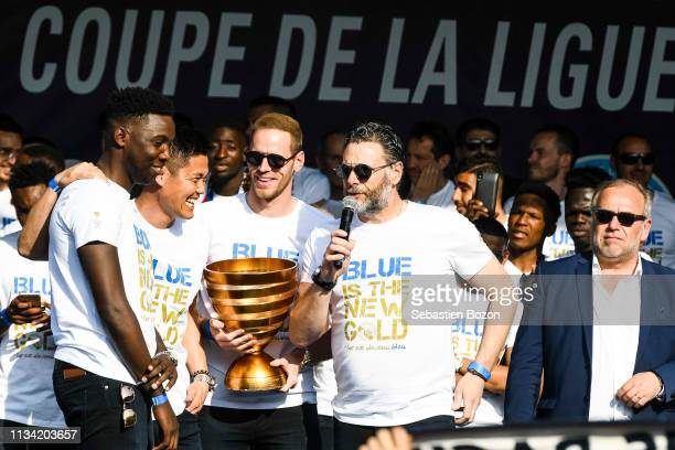 Bingourou Kamara Eiji Kawashima and Matz Selz of RC Strasbourg celebrate winning the French League Cup and present the cup to their fans on March 31...