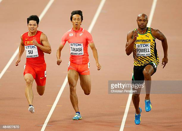 Bingtian Su of China Kei Takase of Japan and Asafa Powell of Jamaica compete in the Men's 100 metres heats during day one of the 15th IAAF World...