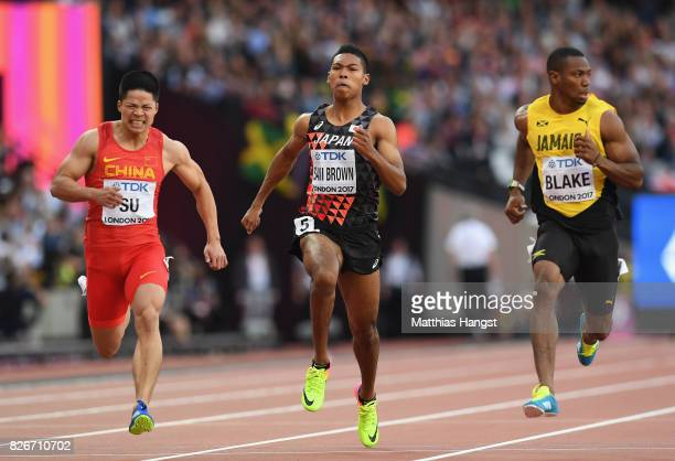 Bingtian Su of China Yohan Blake of Jamaica and Abdul Hakim Sani Brown of Japan compete during the competes in the Men's 100 metres semifinals during...