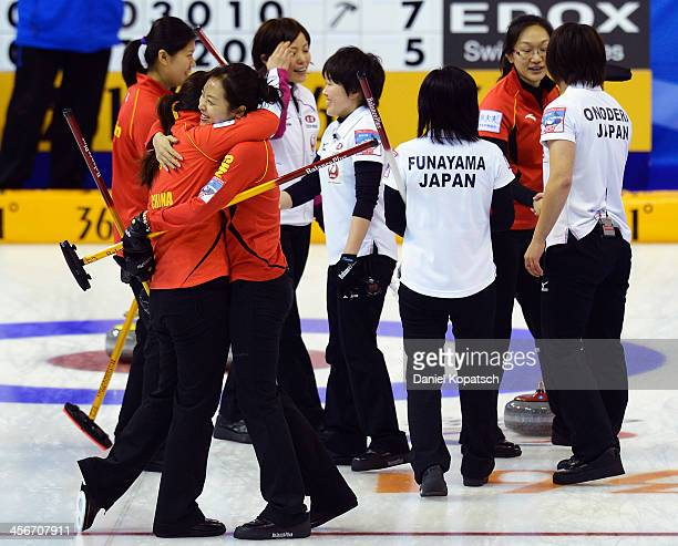 Bingyu Wang of China and team mate Qingshuang Yue celebrate after the Olympic Qualification Tournament playoff match between China and Japan on...