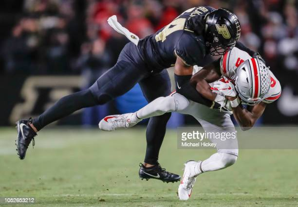 Binjimen Victor of the Ohio State Buckeyes is tackled after the pass reception by Antonio Blackmon of the Purdue Boilermakers at RossAde Stadium on...