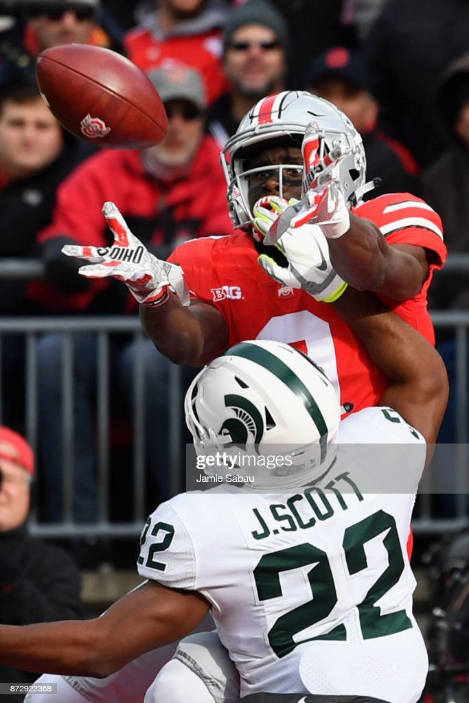 Binjimen Victor #9 of the Ohio State Buckeyes is unable to make the catch in the end zone over the defense of Josiah Scott #22 of the Michigan State Spartans in the third quarter at Ohio Stadium on November 11, 2017 in Columbus, Ohio. Ohio State defeated Michigan State 48-3.