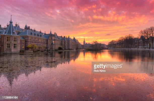 Binnenhof, Dutch Houses of Parliament, reflected in the Court Pond ( Hofvijver ) at Sunset