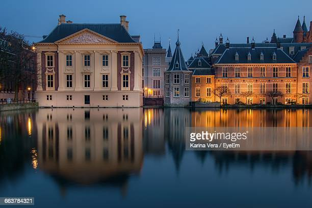 Binnenhof Reflection In Hofvijver Against Sky