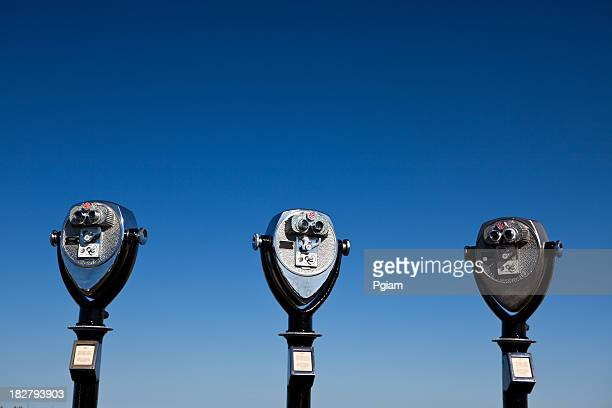 binoculars against the sky - coin operated stock photos and pictures