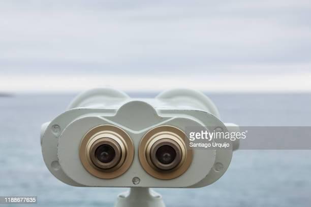 binoculars looking at sea - binoculars stock pictures, royalty-free photos & images
