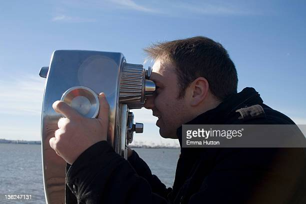 binoculars on liberty island - hutton stock photos and pictures