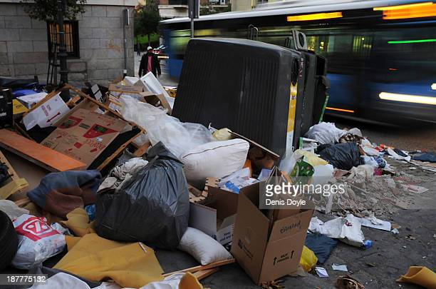 Bins are overflowing with rubbish in the city centre on November 12 2013 in Madrid Spain Street cleaners garbage collectors and public park gardeners...