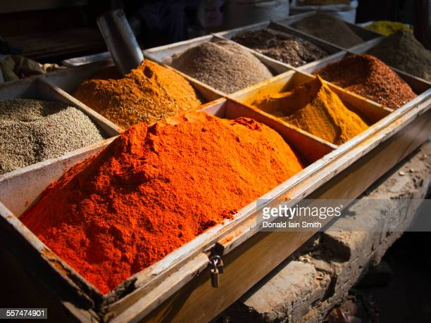 Bins of dried spices for sale in market